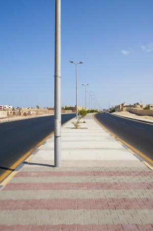 dual: Two lane dual carriageway road in a desert town