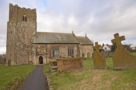 Church and graveyard in an english countryside community photo