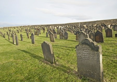 churchyard: Large traditional church cemetery in the countryside with headstones