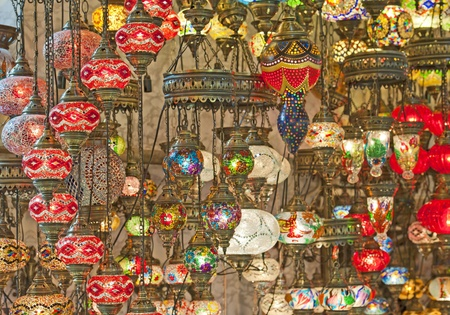 Ornate glass lights hanging in market stall at a souk photo