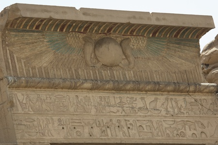 Egyptian hieroglyphic carvings on a wall at the Temple of Kom Ombo photo