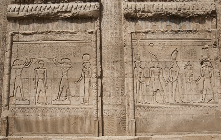 Hieroglyphic carvings on a wall at the Egyptian Temple of Khnum in Esna photo