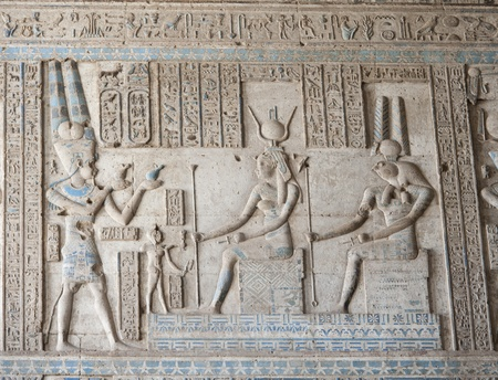 Hieroglyphic carvings and paintings on the interior walls of an ancient egyptian temple Banco de Imagens