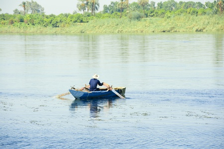 Local Egyptian fisherman in a rowing boat on the River Nile Stock Photo - 10827722