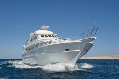 Large luxury motor yacht under way out at sea