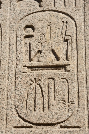 Ancient egyptian hieroglyphic carvings on a temple wall photo