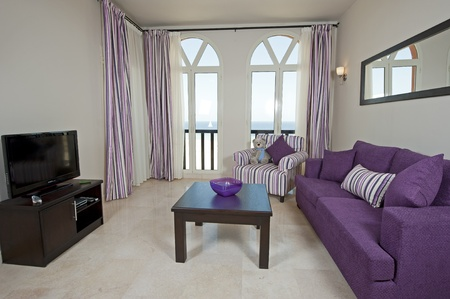 Interior design of a luxury apartment living room with a sea view