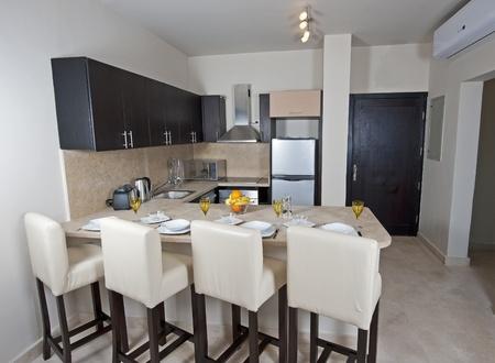 Kitchen area of a luxury apartment Standard-Bild