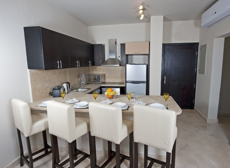Kitchen area of a luxury apartment Stock Photo
