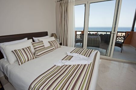 Bedroom on a luxury apartment with a tropical sea view Banco de Imagens - 12647382
