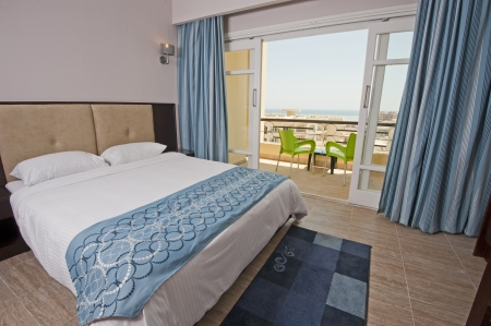 Luxury hotel bedroom with a tropical sea view Standard-Bild