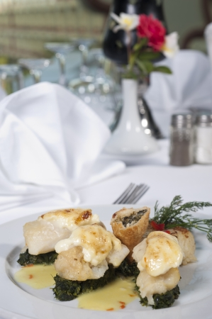 Main meal of fish and spinach a la carte in a restaurant Stock Photo
