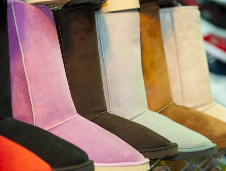 Selection of colorful boots at a market shoe stall
