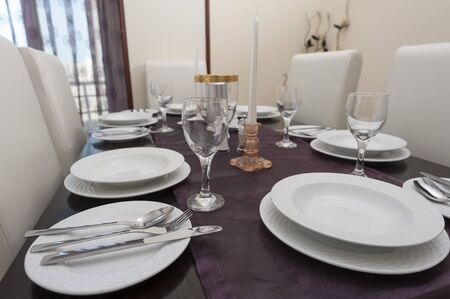Dining room with table and settings in a luxury apartment Stock Photo - 15891725