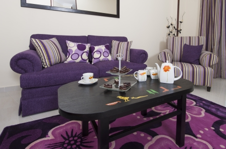 Living room lounge in a luxury apartment showing purple interior design photo