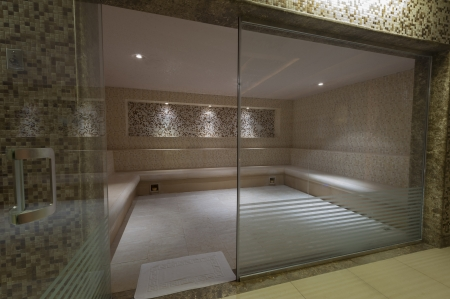 Large steam room with glass door in health spa at a luxury hotel Banco de Imagens - 15919790
