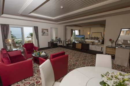 Large suite room in a luxury hotel showing the lounge and bedroom area photo