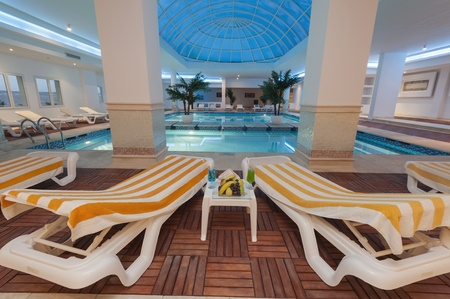 Large indoor sky pool at a luxury hotel with sunbeds photo