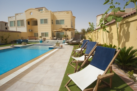show home: Luxury villa show home in a tropical resort with swimming pool and garden Editorial