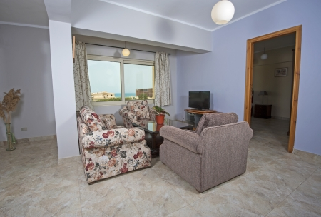 show home: Interior design of luxury show home apartment living room with armchairs and TV