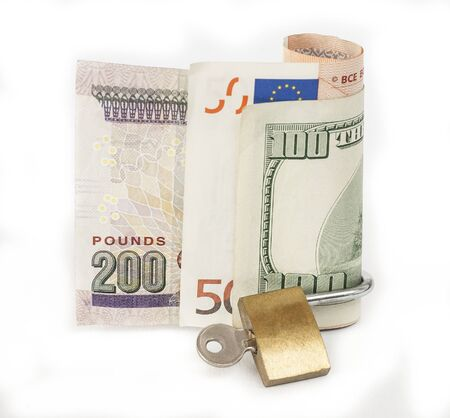 Various foreign currency cash with padlock isolated on a white background concept locked financial security photo