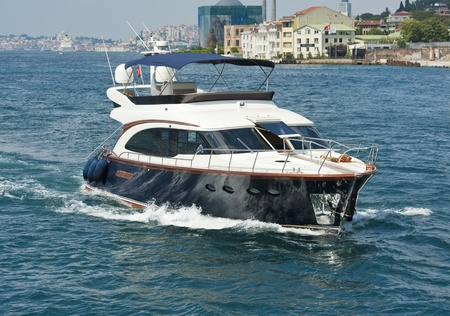 Private luxury motor yacht sailing on a large river though city centre Stock Photo - 21967815