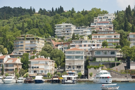 Luxury apartment blocks on hillside next to large river Stock Photo - 21967825