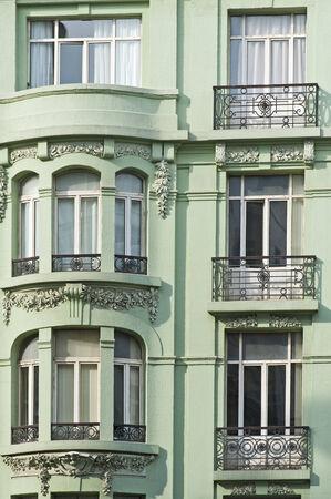 Building exterior wall of a green city center apartment block Stock Photo