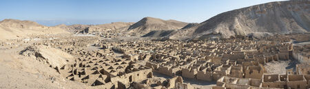 mining town: Panorama over an abandoned ghost town in desert mountains