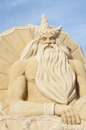 greek god: Large sand sculpture of the greek god of sea poseidon at sand city theme park