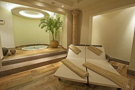 vip area: Beds and jacuzzi in a private VIP area of luxury health spa