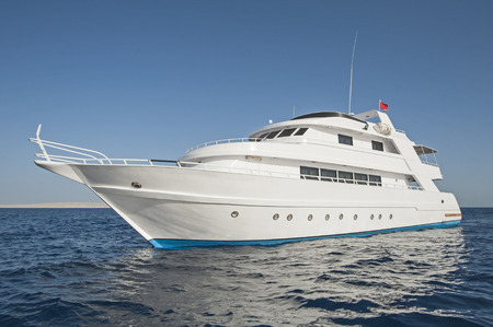 Large luxury private motor yacht out on a tropical sea Standard-Bild