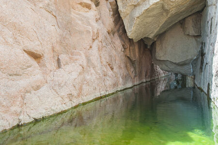 overhang: Freshwater pool under overhang in desert mountain canyon