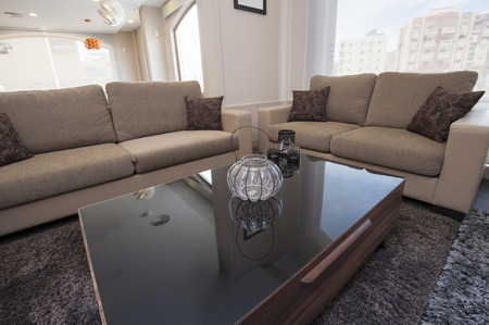 Two brown sofas in living room furniture show home with coffee table photo