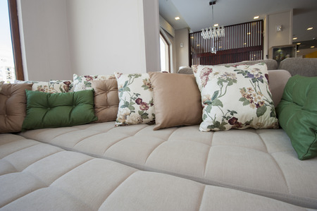 Large sofa closeup detail with cushions on display in furniture showroom photo