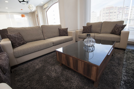 show home: Two brown sofas in living room furniture show home with coffee table Stock Photo