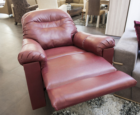 recliner: Red leather reclining armchair in furniture show room