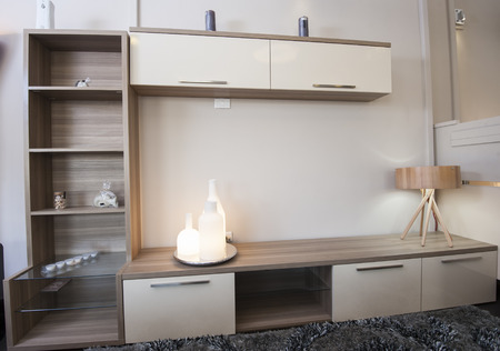 TV shelf unit cabinet on wall in lounge of furniture show room