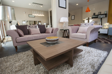 Display lounge area in large furniture show room with sofa and table Stock Photo