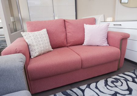 show home: Pink sofa on display in living room of furniture show home