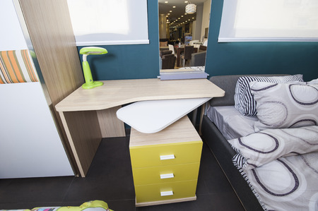 show home: Childrens bedroom area with desk in furniture show home