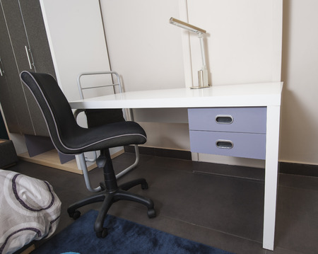 show home: Desk and chair in childrens bedroom area of furniture show home