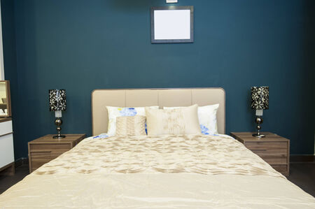 show home: Bedroom area in show home with bedside tables and lamps