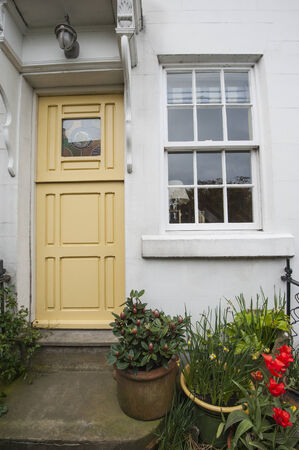quaint: Old country cottage in english rural village with front door