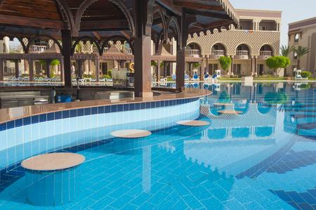 Swimming pool bar in luxury tropical hotel resort Banco de Imagens