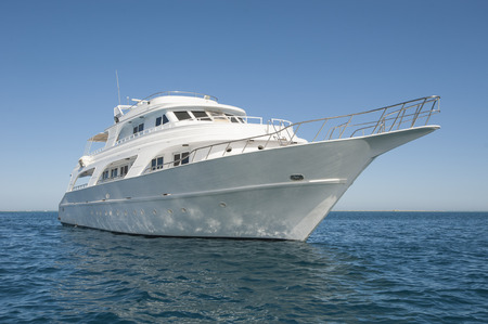 Large luxury private motor yacht out on tropical sea