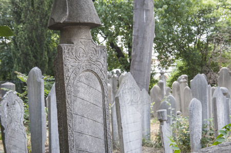 headstones: Old ornate islamic headstones in turkish graveyard Stock Photo