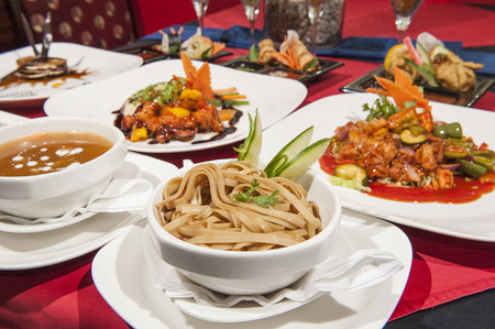 Various selection of chinese meals on table in restaurant Banco de Imagens