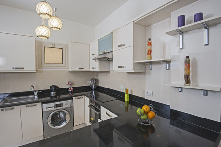 kitchen counter top: American style kitchen area of luxury apartment showing interior design