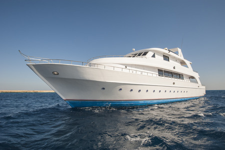 Large luxury motor yacht on a tropical sea Standard-Bild